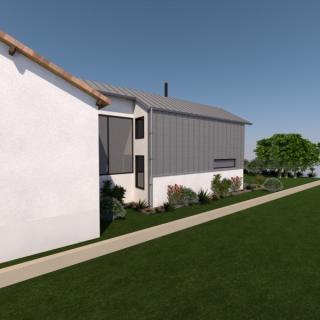 Extension d'une maison de ville en brique et zinc à Villejuif (94)